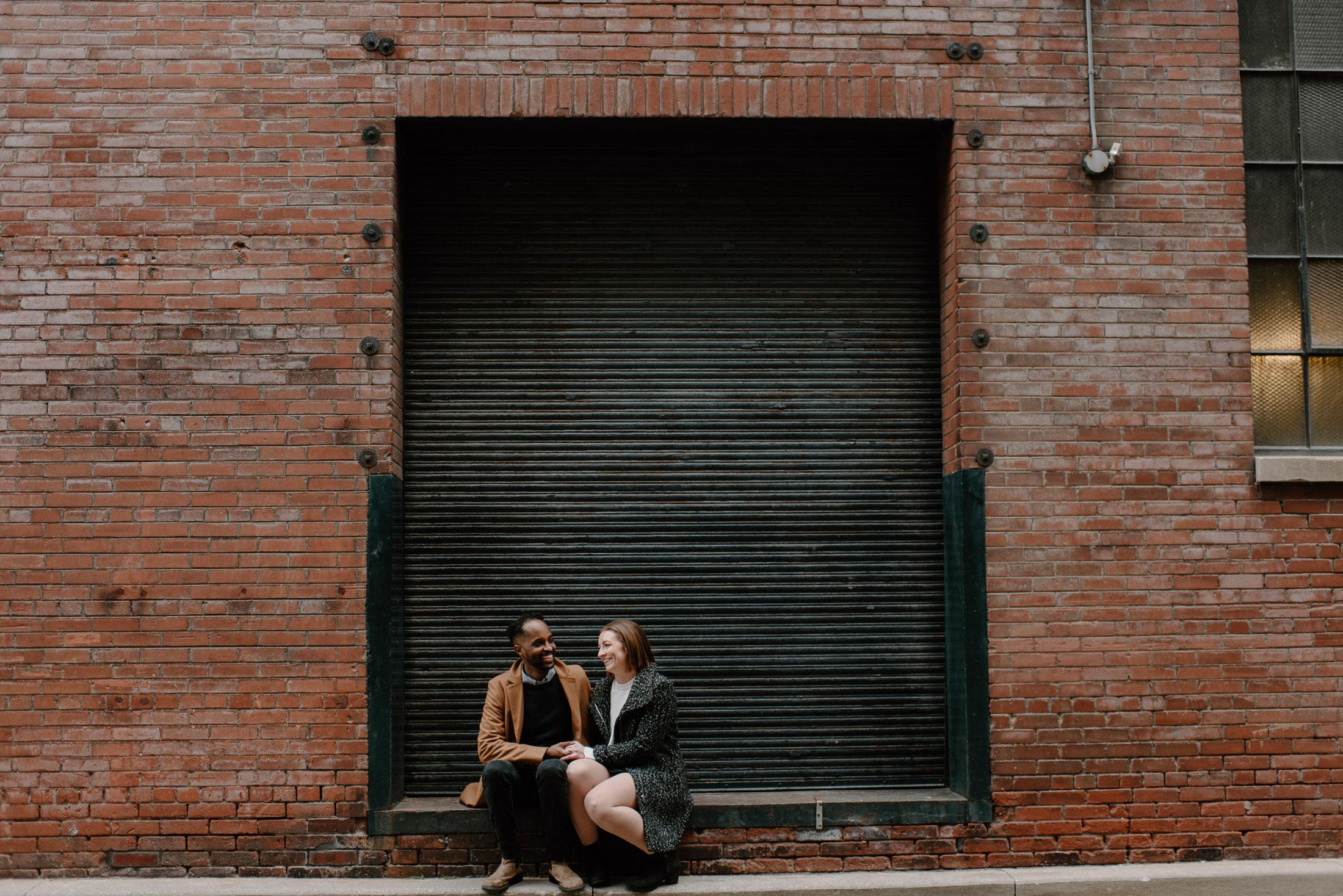 Couple Sitting Liberty Village Toronto
